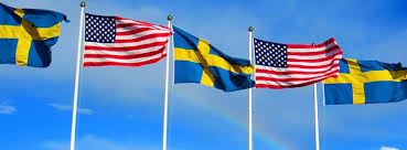 Swedish 3 and American Flags 2 Blue Sky